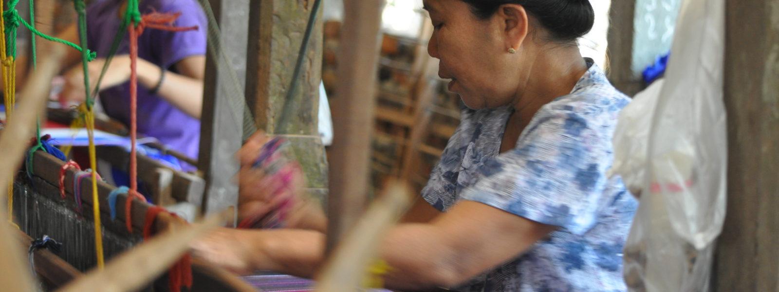 Mawlamyine - Young lady weaving on Ogre Island - Sampan Travel