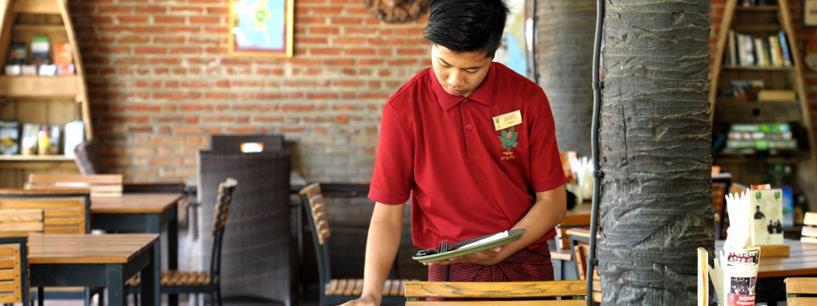 24 Hours in Bagan - student lays the table - Nyaung U Bagan - Sampan Travel