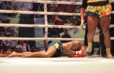 Burmese Boxing - Boxer on floor in ring - Sampan Travel