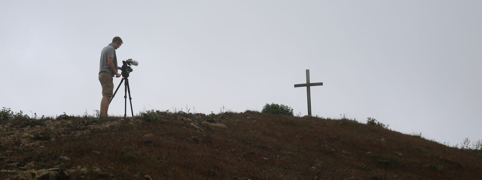 Introducing Forgotten Allies - Luke on hill with crucifix - Myanmar - Sampan Travel