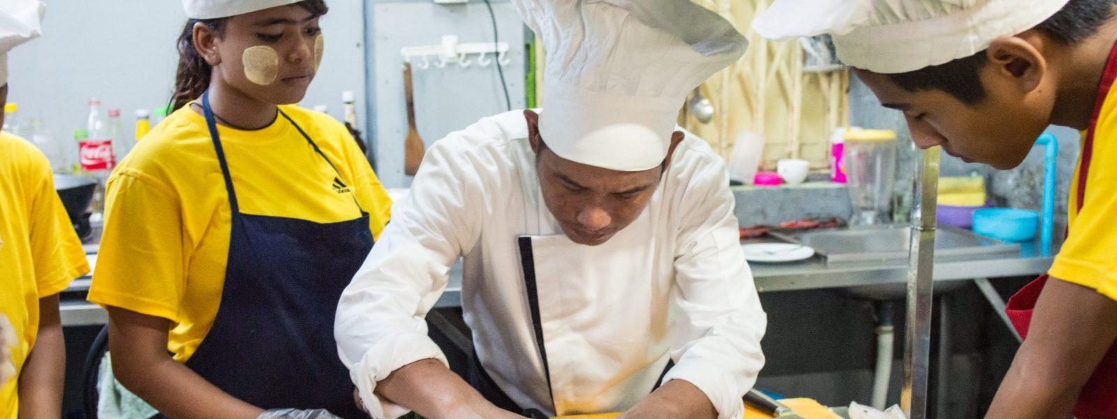 Ma Khin of Linkage - in the kitchen - Yangon - Sampan Travel