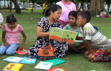 Third Story Project - Reading in the Partk - Myanmar - Sampan Travel