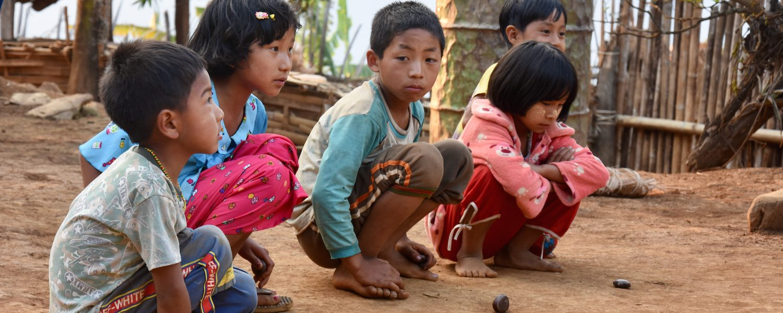 Journey into Nagaland - playing with seed pods - Nagaland, Myanmar - Sampan Travel
