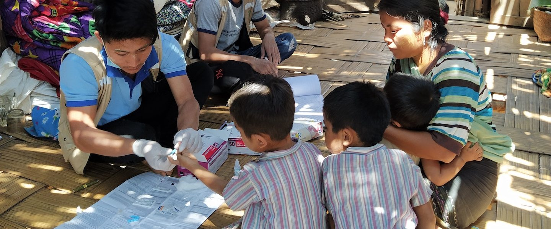 Green Heroes - boys receiving treatment - Myanmar - Sampan Travel